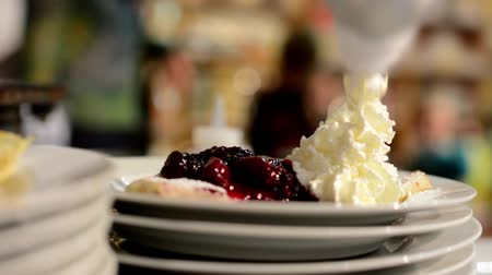 gourmet : chef prepares a pancake (pour jam and whipped cream) Stock Footage