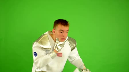 helmets : astronaut takes off his helmet and suffocate - green screen Stock Footage