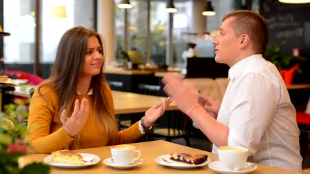 детеныш : unhappy couple argue in cafe - coffee and cake