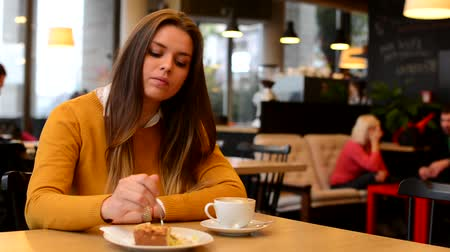 spoons : woman drinks coffee and eat cake in cafe