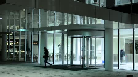 entrance : modern building and people leave and enter to the building office Stock Footage