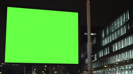 billboards : billboard - green screen - night - building (offices) windows Stock Footage