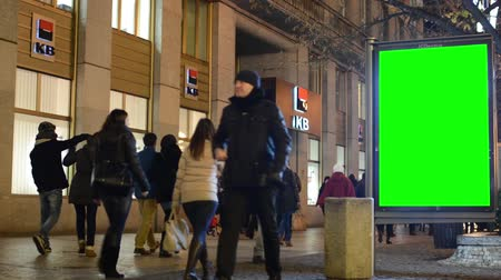 billboards : billboard in the city - urban street with building (bank)- green screen - walking people - night Stock Footage