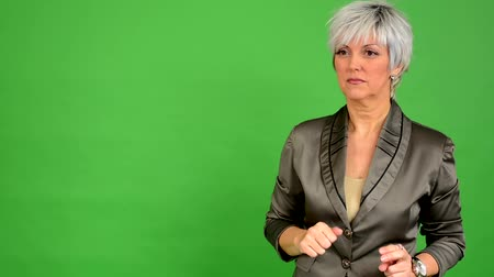 orta : business middle aged woman speaks (talking) - green screen - studio