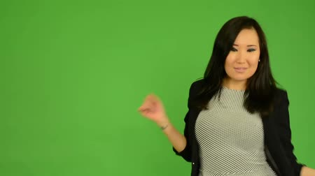 vzrušený : young attractive asian woman dancing - green screen studio