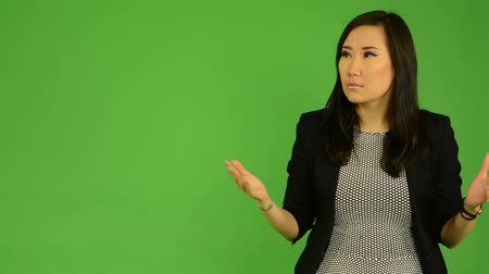 izgatott : young attractive asian woman is surprised - green screen studio Stock mozgókép