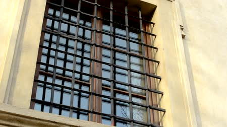 jail bars : barred window - building Stock Footage