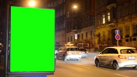 reklama : billboard - green screen - night city - urban street with cars - timelapse