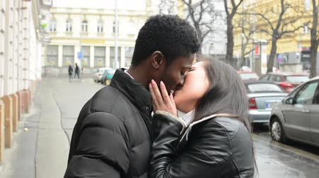 genç çift : young model happy couple in love (black man and asian woman) - couple kiss