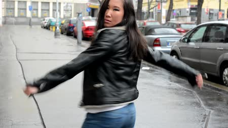 деловая женщина : young attractive asian woman dancing - urban street - city