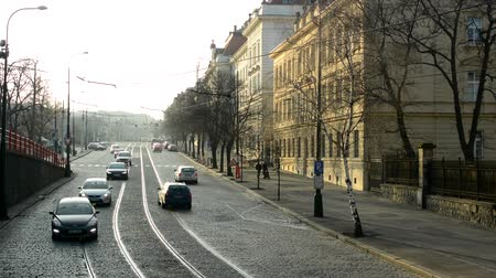 godo : PRAGUE, CZECH REPUBLIC - FEBRUARY 6, 2015: urban street with cars and trams - buildings in sunlight