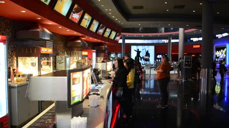 bilet : PRAGUE, CZECH REPUBLIC - FEBRUARY 28, 2015: snack bar in the cinema with people