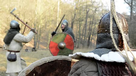 war field : PRAGUE, CZECH REPUBLIC - FEBRUARY 21, 2015: medieval battle - war - soldiers fight - men fight and soldier watches them