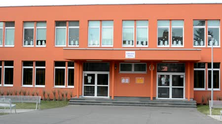entrance : CZECH REPUBLIC, PRAGUE - FEBRUARY 4, 2014: exterior primary school - cloudy Stock Footage