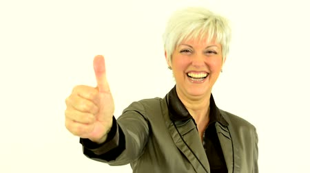 amadurecer : business middle aged woman shows thumb on agreement and laughs - white background - studio