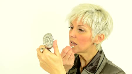 ruj : business middle aged woman uses make up - cosmetic