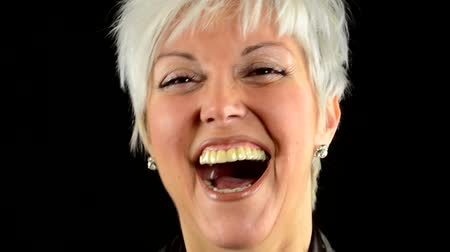 смеющийся : business middle aged woman laughs - black background - studio - detail (closeup)