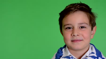 arc : young handsome child boy smiles to camera - green screen - closeup - studio
