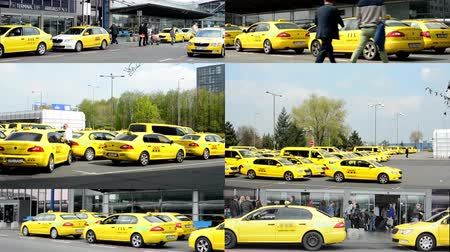 çek cumhuriyeti : PRAGUE, CZECH REPUBLIC - APRIL 2014: 4K montage (compilation) - Airport Prague - people outside the airport (building) with taxi cars - car park with taxi cars Stok Video