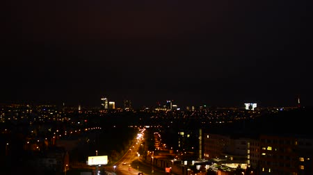 night : night city - urban street with cars - lights - dark sky - timelapse