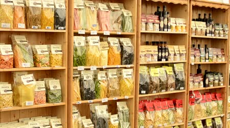 olive colored : colourful pasta olive oil flour etc. in bags in shelf  shop  usable as background