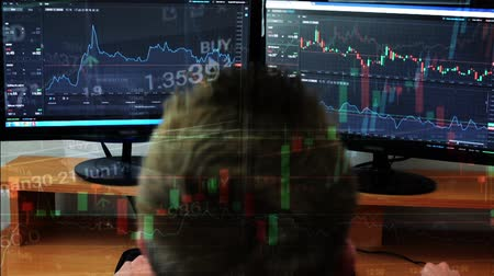 Man works on the financial market exchange on computer