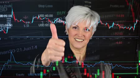 handlowiec : business middle aged woman shows thumb on agreement  financial market exchange  graph Wideo