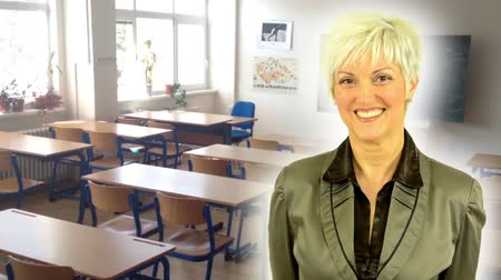 orta : business middle aged woman smiles  school class  empty with board Stok Video