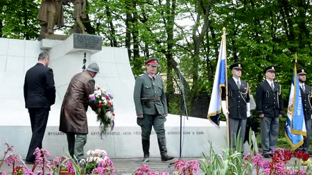 veteran's day : PRAGUE CZECH REPUBLIC  MAY 2 2015: commemorate the victims of World War II at the cemetery  official clerk and soldier put down flowers on the grave