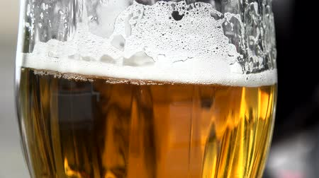 beer tap : glass of beer - close