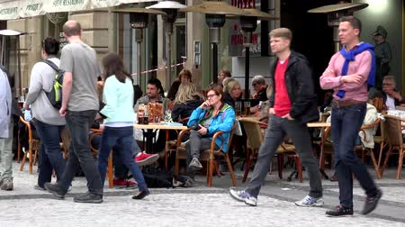 gyalogút : PRAGUE, CZECH REPUBLIC - MAY 30, 2015: The city - Urban street - sidewalk with people walking - restaurant: Outdoor seating sitting with people