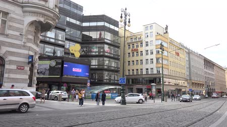 billboards : PRAGUE, CZECH REPUBLIC - MAY 30, 2015: The city - Urban street with passing cars and walking people - buildings - video billboard