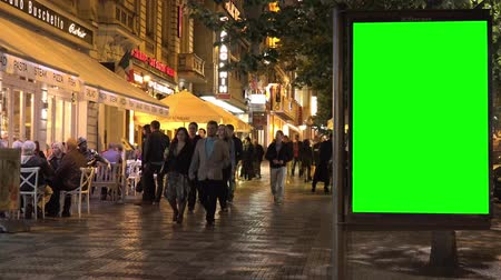billboards : PRAGUE, CZECH REPUBLIC - MAY 30, 2015: billboard in the city - urban street with buildings - green screen - people