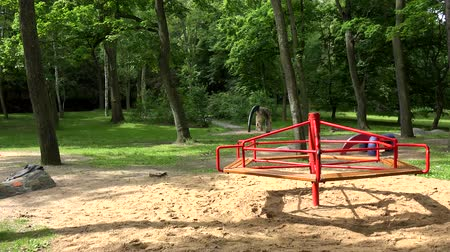 gidip : empty playground in the park forest - summer