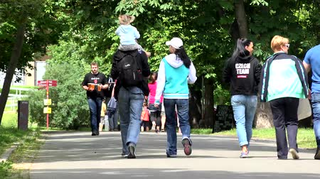 small park : PRAGUE, CZECH REPUBLIC - MAY 31, 2015: people walking in the park - summer