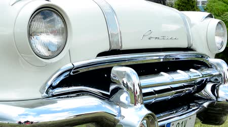 antika : PRAGUE, CZECH REPUBLIC - JUNE 20, 2015: The old vintage american car - front closeup: headlights