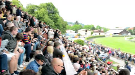 horse racing : PRAGUE, CZECH REPUBLIC - JUNE 21, 2015: horse races - the audience - people cheering the horses - jockeys ride on horses on the circuit
