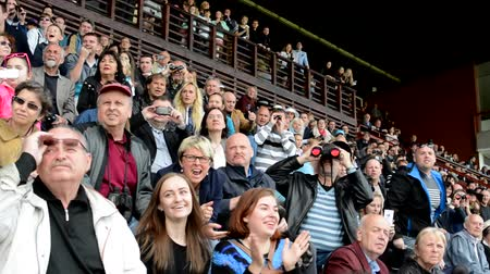 horse racing : PRAGUE, CZECH REPUBLIC - JUNE 21, 2015: horse races - the audience - people cheering the horses Stock Footage