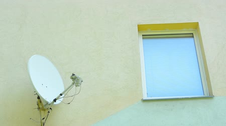 satelite : satellite on the wall of house next to the windows - close up Wideo