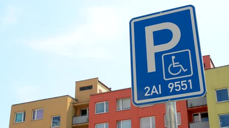 priority : CZECH REPUBLIC, PRAGUE - JULY 7, 2015: camera focus traffic sign parking - reserved for specific car with handicapped person - detail