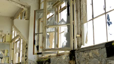 yıkım : CZECH REPUBLIC, PRAGUE - JULY 10, 2015: many windows in the dirty deserted room in the old building Stok Video
