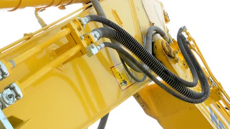 plated : detail of the excavator arm in the countryside - close up Stock Footage