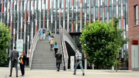 ventoso : CZECH REPUBLIC, PRAGUE - JULY 14, 2015: view of the large modern building with stairs before - people walk - breeze blows