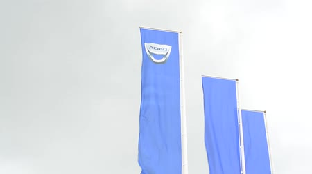 loga : CZECH REPUBLIC, PRAGUE - JULY 15, 2015: blue flags with dacia logo in outside - breeze blows
