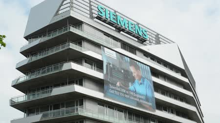 komerční : CZECH REPUBLIC, PRAGUE - JULY 16, 2015: view of the tall modern building of siemens company in the city