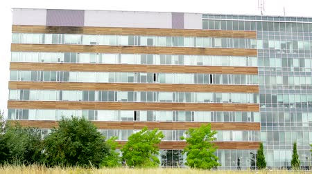 view of the complex building in the suburb surrounded by trees and grass Stock Footage