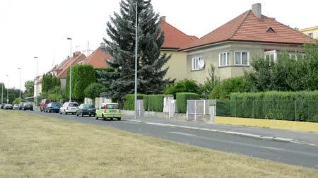 дымоход : Parked cars on the road in front of family houses