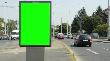 view of the billboard stands on the side of two roads in the suburb - green screen Stock Footage
