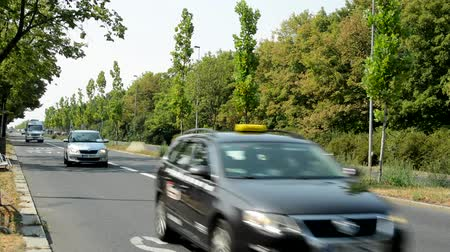 view of the road in the nature - many cars pass through the countryside
