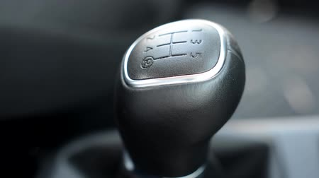 gearstick : detail of the shift lever inside the modern car